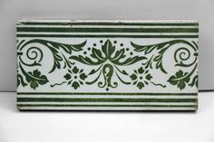 Green and white tile