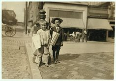 "Date: June 1911Location: Richmond, Virginia Two Newsboys' Richard Green (with hat), 5 years old, and Richmond, who was ""8""."