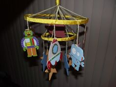 New mobile I created for my son's nursery. Couldn't find a mobile I liked that matched the retro space theme I am using for his nursery so I created this one using some really cute wooden figures I found at Hobby Lobby. Ordered a mobile mounting arm and music box off of ebay. Voila - cute mobile for about 20-25 dollars :-)