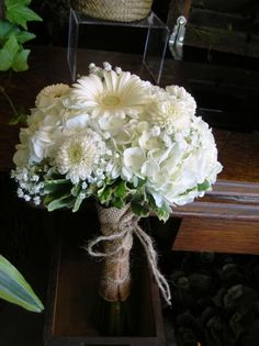 [Image: Vintage bridal bouquet of white hydrangea, button mums, gerbera daisies and baby's breath. Finished ]
