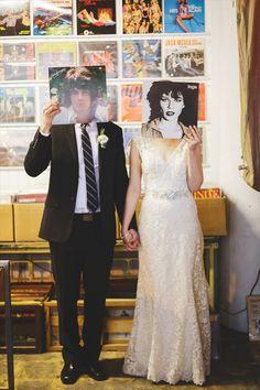 bride and groom - record store | Rachael Schirano Photography - peoria wedding
