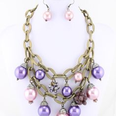 Double Row Dangling Pearl Necklace Double Row Dangling Pearl Necklace Color / Purple / Material/ Gold Burnish Plating /Description 18 inch longest strand. Pearl. Glass. Plated. Accessories