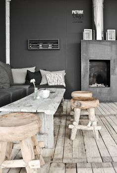 Dark, dark gray and light wash wood are perfect and perfectly unexpected bedfellows in this interior....