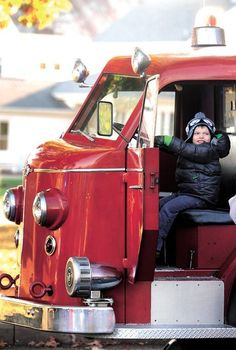 Maxwell Hambleton, 4, of New Philadelphia, checks out a 1949 American LaFrance fire engine from the New Philadelphia Fire Department during Sunday's fall festival hosted by the city at Tuscora Park.