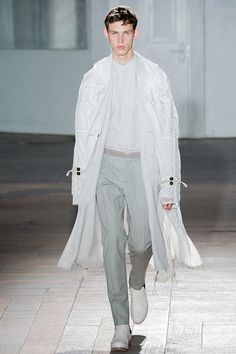 4d89f31883 Men in trench coats from Paris Fashion Week Spring and Summer 2015. From GQ  magazine