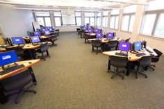 A large electronic classroom with 30 computer stations, networking, and an instructor console for control and monitoring.