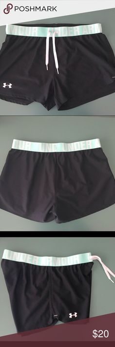 Under Armour Women's HeatGear shorts Women's size small in black/aqua. Under Armour loose fit shorts with drawstring. Only worn once in great condition. Under Armour Shorts
