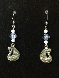 Light Blue and White Swan Earrings by queenofqeeks on Etsy, $8.00