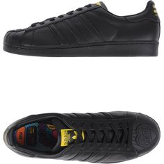 Adidas Originals By Pharrell Williams Low-tops & Trainers ($95) ❤ liked on Polyvore featuring shoes, sneakers, black, flat sneakers, black flat shoes, adidas originals shoes, black sneakers and leather flat shoes