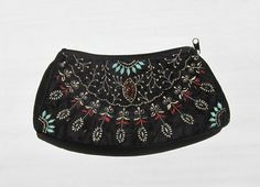 Vintage black embroidered and beaded evening clutch purse. $33.00, via Etsy.