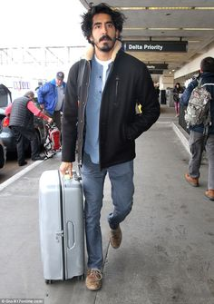 Laid-back lad: Jetting out of Los Angeles' LAX on Tuesday evening, Dev Patel, 26, cut a la...