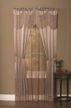 """Achim Home Furnishings Halley Window in a Bag, 56-Inch by 84-Inch, Sage by Achim Home Furnishings. $30.46. 56-Inch by 84-Inch. Complete """"window in a bag"""" set comes with 2 imitation satin panels w/fringe bottom, 1 solid color voile panel, 1 silky string austrian valance and 2 tasseled tiebacks.. 100-percent polyester. The luxurious look of satin enhanced with stragds of silky look polyester create an Austrian valance. Panels are detailed with tassels at the bottom.. Save 34%!"""