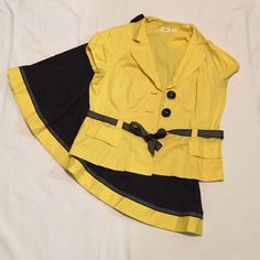 2pc Skirt suit yellow/black sz 16 Black skirt with polka dot ribbon bottom, 97% Cotton 3% Spandex jacket with 3 large buttons, black and white ribbon belt, and 2 front pockets. 10% off 2 or more bundled items. Cato Other