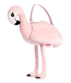 Lys rosa. Håndtaske udformet som en flamingo. Tasken er i blød velour med vinger i imiteret pels. Lynlås foroven og hank i imiteret læder. Polyestervatteret