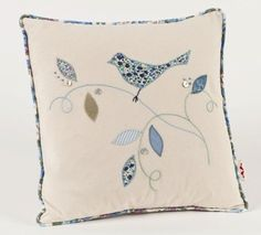 This cushion from our Little Bird range is appliquéd with a bird on a sprig of leaves using 100 natural fabrics in shades of blue and green The Diy Cushion, Cushion Covers, Cushion Pillow, Sewing Pillows, Diy Pillows, Decorative Pillows, Free Motion Embroidery, Machine Embroidery, Country Cushions