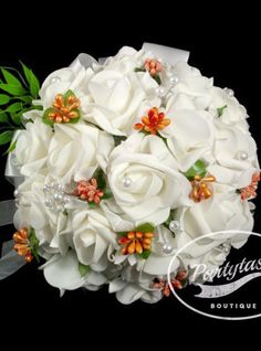 Delicate white wedding bouquet from white roses, pearls,satin and organza This Chic classic bridal bouquet is made of neoprene roses, pearls, orange buds, satin and organza. The stems are wrapped in w