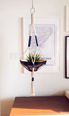 Show your plants some love with this modern macrame plant hanger. Simple, yet meticulously hand-crafted, this beauty would be equally at home gracing a livin. Macrame Hanging Planter, Macrame Plant Holder, Hanging Planters, Plant Holders, Macrame Design, Macrame Art, Macrame Patterns, Macrame Plant Hanger Patterns, Room Corner