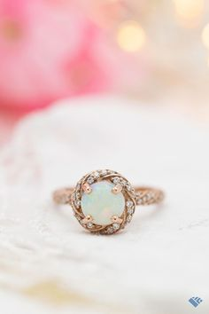 This pretty white opal is set in a twisting, floral rose gold halo, with that twist echoed all down the length of the band. Elegant curves of sparkling moissanites on every surface! Classic Engagement Rings, Engagement Ring Styles, White Opal, Her Style, Ring Designs, Fashion Rings, Halo, Curves, Surface
