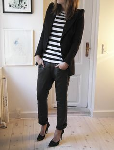 Pairing stripes with a blazer adds a polished look to a casual outfit.