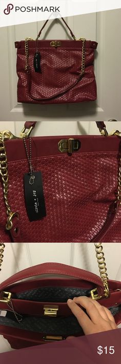 Olivia and joy Hand bag NWT. Never used. Olivia and joy Hand bag. Good size. With two large pockets. Smaller pockets on inside. Red and Gold with a basket weave patter. Olivia + Joy Bags Shoulder Bags