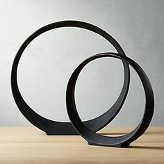 Metal Ring Sculptures, Home Accessories, Shop Metal Ring Sculptures. Black cast aluminum circle stands firm like a piece of art, open for interpretation. Sculptural edges curve round for adde.