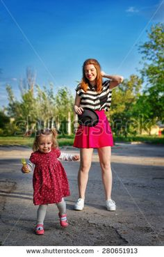 The older and younger sister for a walk in a city park. The concept of family happiness. Family Stock Photo, Park City, Sisters, Old Things, Happiness, Concept, Stock Photos, Style, Fashion