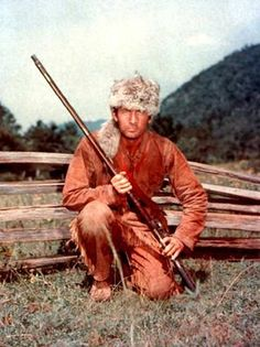 Davy...Davy Crockett -- King of the Wild Frontier!  I Cried at the Alamo...bros had coonskin caps... Betsy, his rifle..