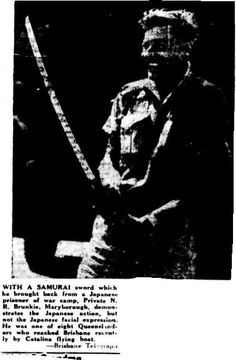 1945 Private N R Brunkie of Maryborough with a Samurai Sword he brought back from a Japanese Prisoner of War Camp.
