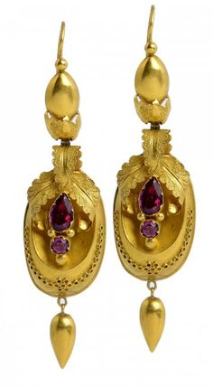 A PAIR OF VICTORIAN GOLD AND FOILED RUBY EARRINGS, C1850  of leafy oval pendant design, on wire loops, 60mm, 4.2g  Sold @ Mellors & Kirk