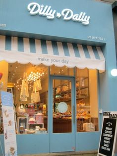 This is a cute bakery front but I like the idea of a striped awning for a photo studio!: