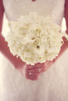 This bride carried a white hydrangea and calla lily bouquet at her Disneyland wedding