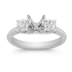 This classic engagement ring features two round diamonds, at approximately .47 carat total weight, set in quality 14 karat white gold. Add the center diamond of your choice to make this ring all your own.
