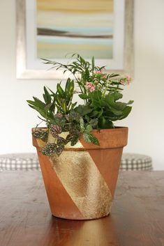 Gold leaf applied on terra cotta, for an easy splash of interest to jazz up a plain planted pot.