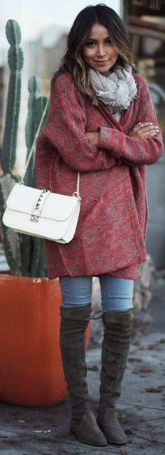 Winter layering: red cardigan, jeans, suede over-the-knee boots, grey scarf and a white cross body bag.