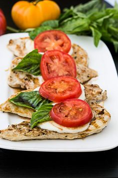 Want to enjoy a low-carb dinner? Make this simple caprese chicken, which marries the fresh flavors of a caprese salad with a dose of lean protein. Ripe tomatoes, tangy balsamic and fragrant basil are a yummy ways to dress up your lean chicken breast. Low Carb Dinner Recipes, Clean Eating Recipes, Healthy Eating, Cooking Recipes, Healthy Recipes, Diet Recipes, Clean Eating Chicken, Clean Eating Dinner, Protein Recipes