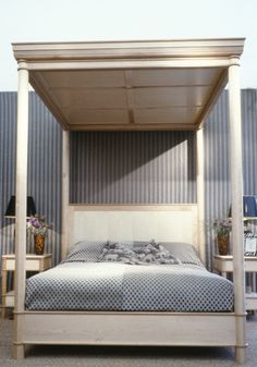 A bedroom displayed at Decorex in 1997, which has a large wardrobe,a four poster bed and two bedside tables designed and made by Tim Wood.  This wardrobe is made out of maple, European oak, birds eye maple and with cedar of Lebanon interiors. The strong sweet spelling cedar of Lebanon is a great way of detering moths. In the back of the break fronted central part of the wardrobe we place adjustable shelves for extensive handbag storage. The large drawers in the base were very generous in…