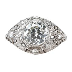 Spectacular Edwardian Era Engagement Ring with Feminine Filigree   From a unique collection of vintage engagement rings at https://www.1stdibs.com/jewelry/rings/engagement-rings/
