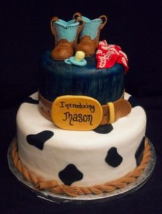 Cute western baby shower cake with cowboy boots and belt buckle. So cute!