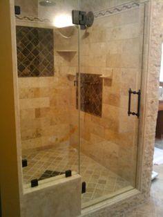 A beautiful frameless glass shower door.