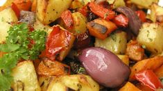Butternut squash, sweet potato, red peppers, and Yukon Gold potatoes are roasted with olive oil, balsamic vinegar, and herbs in this easy side dish.