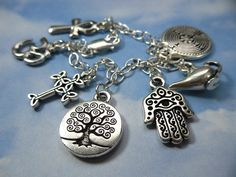 Not religious but I do love this charm bracelet!     Ancient Religions Charm Bracelet- om, hamsa, tree of life, cross, ankh, labyrinth, genie