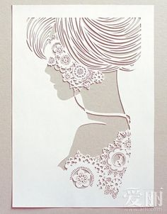 Don't know who this papercut artist is, but the art sure is pretty.