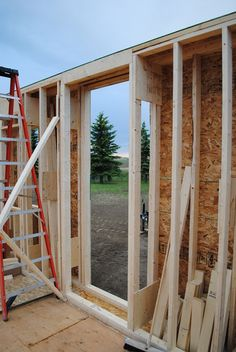 Exterior walls consist of two parallel 2x4 walls with an 8-inch space between them. Both 2x4 walls are framed 16 inches on center and have a double bottom plate to accommodate a 1 1/2-inch thick concrete floor. The inner wall is load-bearing.