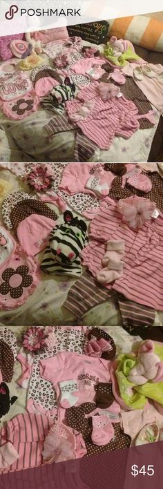I call this pretty in pink !!   A 12 mths Every piece here is brand new never been worn or used. ,you have 5 beanie hats ,4 really cute head bands ,4 pairs of socks3 bibs,1 hand puppet,1 wobe,1pray pillow,1 baby doll shoes,1 blanket ND 1 ballerina rabbit ,ND one out fit top ND bottom Geber Other