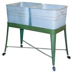 Keep craft supplies organized in the sewing room or store folded throws in the linen closet with this 2-bucket cart, featuring a distressed base and wheels f...