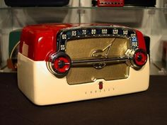 red and cream coloured vintage Crosley Bakelite radio