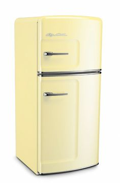 """She went to her kitchen and opened up the Big Chill buttercup yellow refrigerator.""  Studio Size Big Chill Retro Refrigerator"