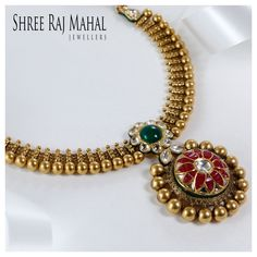 This mesmerizing antique gold necklace inspired by Indian tradition is encrusted with kundan , emeralds and rubies, creating enchanting flower motifs. The Gold bead drops add extraordinary charm to the design which befits the bride. #gold #necklace #ShreeRajMahalJewellers #southex #delhi