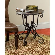 @Overstock.com - Safavieh Taylor Side Table with Scroll Base - The iron scroll base of this distressed black side table makes this table an elegant addition to any room in your house. A beautifully distressed, crackle lacquer top adds charm, while its solid black finish blends in with any decor.   http://www.overstock.com/Home-Garden/Safavieh-Taylor-Side-Table-with-Scroll-Base/4378580/product.html?CID=214117 $89.99