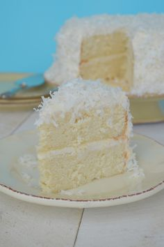 Coconut Cake with Coconut Cream Cheese Frosting......Moist, Dense, Crazy Delicious!!!